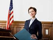 Portrait of a female lawyer standing in a courtroom and smiling