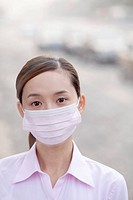 Chinese businesswoman wearing surgical mask