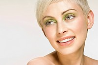 Portrait of smiling woman wearing green eye shadow