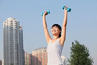 Chinese woman lifting hand weights