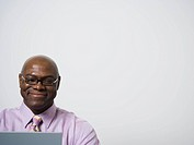 Close_up of a businessman in front of a laptop