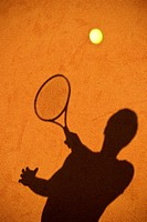 Tennis player on clay court.
