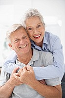 Spain, Senior couple in hotel, smiling, portrait
