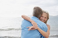 Spain, Mallorca, Senior couple embracing on beach (thumbnail)
