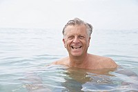 Spain, Senior man swimming in sea