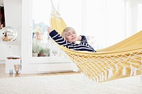 Germany, Bavaria, Munich, Woman relaxing in hammock