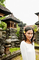 Young Balinese woman at temple, Bali, Indonesia.