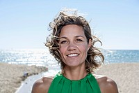 Spain, Mid adult woman smiling, portrait (thumbnail)