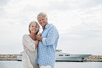 Spain, Senior couple at harbour, smiling, portrait