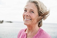 Spain, Senior woman smiling at Atlantic ocean (thumbnail)