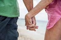 Spain, Seniors couple holding hands, close up