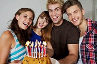 Germany, Berlin, Group of young people celebrating birthday