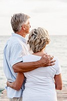 Spain, Senior couple standing at the sea (thumbnail)