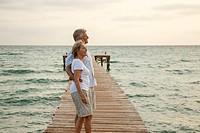 Spain, Senior couple standing on jetty at the sea