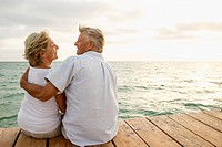 Spain, Senior couple embracing at the sea (thumbnail)