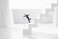 Spain, Businessman falling down from ladders (thumbnail)
