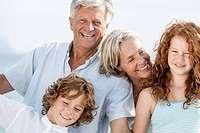 Spain, Grandparents with grandchildren at the sea, smiling, portrait