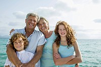 Spain, Grandparents with grandchildren at the sea, smiling, portrait