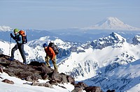 USA, Washington State, Cascade Mountains, two hikers climbing on mountain ridge, side view
