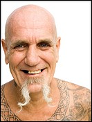 Heavily tattooed man smiling