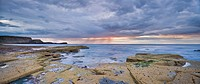 A showery evening at low tide in saltwick bay, saltwick bay north yorkshire england