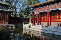 Colourful ornate buildings along the water´s edge, beijing china