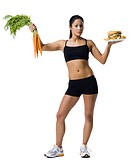 Woman choosing between carrots or hamburger