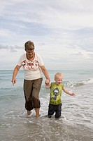Grandmother and grandson playing in ocean