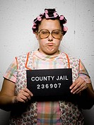 Mug shot of housewife with curlers