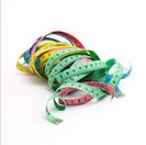 Interwoven multi_coloured measuring tapes