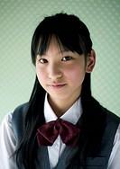 Teenagegirl smiling with wearing school uniform