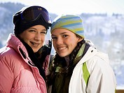 Two teenage girls outdoors in winter with toques