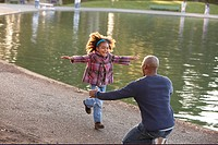 Little girl running into her father´s arms.