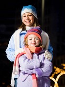 Two girls outdoors in winter smiling