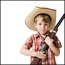 Boy with toy rifle and cowboy hat