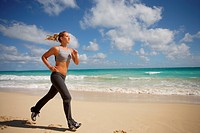 female runner on beach