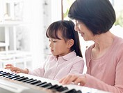 Girl who practices piano with grandma