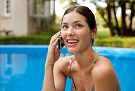 woman at the pool, talking on mobile phone