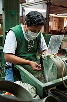 Workers polishing jade at the Casa del Jade Jade House Factory and Museum, Antigua, Guatemala, Central America