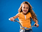 Girl riding bicycle and smiling