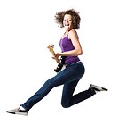 Girl with braces and guitar leaping and sticking tongue out
