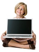 girl holding a laptop computer