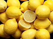 Slice of lemon amongst a group of lemons