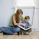mother reading with child