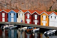 Colourful traditional fishing huts and boathouses along wooden pier at Smögen, Bohuslän, Sweden