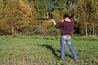 The girl aims from a gun