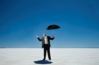 business person holding an umbrella