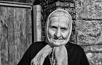 Portrait older woman in front of house in small village in Poznan Poland