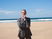 Businessman standing at the beach