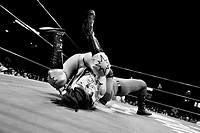 "A female Lucha libre wrestler pins down her rival during a fight at Arena Mexico in Mexico City, Mexico, 26 April 2011  Lucha libre, literally ""free f..."